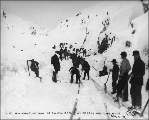 Clearing the tracks of the White Pass & Yukon Railroad after a snow storm, Alaska, March 17,...