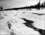White Horse Rapids on the Yukon River frozen over in winter, Yukon Territory, ca. 1898.