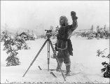 Surveyor Strong at work probably for the White Pass & Yukon Railroad between Summit and Log...