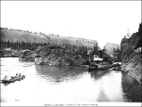 Guiding a steamboat using ropes through Five Finger Rapids on the Yukon River, Yukon Territory,...