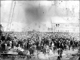Crowd of people celebrating U.S. naval victories during the Spanish-American War, Dawson, Yukon...