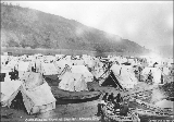 Klondikers camping along the river, Dawson, Yukon Territory, 1898.