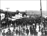 Large crowd viewing races on Front St. for July 4th celebration, Dawson, Yukon Territory, 1899.