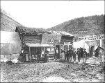 Men and women standing outside of the Magnet Roadhouse, Bonanza, Yukon Territory, ca. 1898.