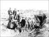 Miners working the No. 7 bench claim, Anvil Creek, Alaska, ca. 1900.