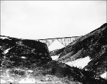 Steel arch bridge spanning Dead Horse Gulch near the summit of White Pass on the White Pass and...