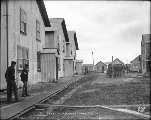 Soldiers standing outside of U.S. Army barracks, Nome, Alaska, ca. 1900.