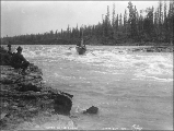 Boat navigating the Whitehorse Rapids on the Yukon River, Yukon Territory, 1898.