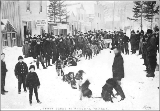 Dogsled team in street surrounded by crowd, Skagway, Alaska, ca. 1898.