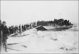 People boarding scow on Nome beach, Alaska, ca. 1900.