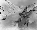 Klondiker with horse drawn sled in Cutoff Canyon heading toward White Pass summit, Alaska, March...