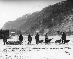 Dogsled team with five men arriving in Skagway, Alaska from Dawson, December 28, 1898.