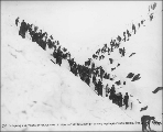 Clearing the tracks of the White Pass & Yukon Railroad after a snow storm on the summit of...
