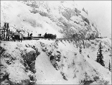Work train hauling lumber for the construction of the White Pass & Yukon Railroad during the...