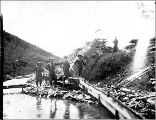 Four miners engaged in sluicing operation, Yukon Territory, ca. 1898.