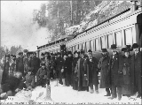 Passengers disembarking from the White Pass & Yukon Railroad to view scenery from Porcupine...
