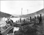Klondikers with scows and supplies camped at  Dawson, Yukon Territory, ca. 1898.