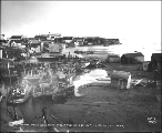 Snake River from the bridge showing the aftermath of a storm in October 1902, Nome, Alaska.