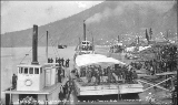 Steamboat BELLA departing from Dawson with eight tons of gold, Yukon Territory, 1898.
