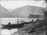 Mr. Grant, Peter Hegg, and P.B. Anderson on the bank of the Yukon River panning for gold, Yukon...