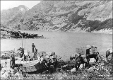 Klondikers unloading freight from pack horses, south end of Long Lake, Chilkoot Trail, British...