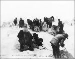 Klondikers caught in snow storm on the summit of White Pass, Alaska, 1898