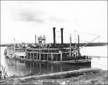 Alaska Commercial Co. steamboat HANNAH tied to a landing on the Yukon River, Yukon Territory, ca....