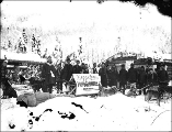 Dogsled team with advertisement for Hegg and Larss photographers, Yukon Territory, ca. 1898.