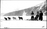 Dogsled with two women and man dressed in furs, Dawson, Yukon Territory, ca. 1898.
