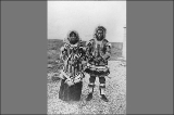 Eskimos known as Princess Ker-leng-ner and her husband wearing fur parkas, Port Clarence, Alaska,...
