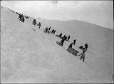 Klondikers with supplies climbing to the summit of Chilkoot Pass, Alaska, 1898.