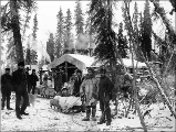 First survey party leaving Trans Alaska Co.'s camp at Holy Cross (formerly Kozherevsky), Alaska,...