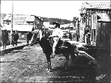 Captain Jack Crawford on horseback, Marshal for the July 4th celebration, Dawson, Yukon Territory,...