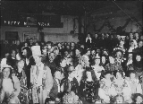 Masquerade Ball to celebrate the New Year, Pioneer Hall, Dawson, Yukon Territory, ca. 1899.