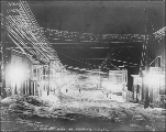 Winter street scene at night, Cordova, Alaska, ca. 1908.