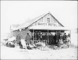 Dogsled team and group of people in front of Savoy Hotel, Yukon Territory, ca. 1898