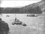 Scows and small boats navigating Squaw Rapids between Miles Canyon and Whitehorse Rapids on the...