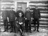 North-West Mounted Police posed in front of log cabin, Dawson, Yukon Territory, ca. 1898.