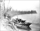 Hegg party with their boats tied up to the riverbank near Stewart City on the Stewart River, Yukon...