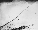 Klondikers ascending to the summit of Chilkoot Pass, Alaska, 1898