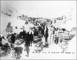 Klondikers waiting in line for customs, Chilkoot Pass, Alaska,  ca. 1898.