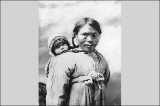 Eskimo mother with infant on her back, Alaska, ca. 1901.