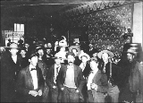 Men and women at the bar of the Monte Carlo, Dawson, Yukon Territory, ca. 1898.