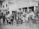 Klondikers with pack horses outside of the Dawson Market, Front St., Dawson, Yukon Territory, June...