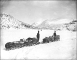 Klondikers with sled drawn by Angora goat team on a frozen lake, probably British Columbia, ca....