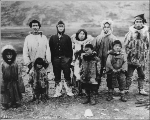 Eskimo men, women and children wearing native and western clothing, Alaska, ca. 1900.