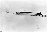 Passenger train of the White Pass & Yukon Railroad descending from White Pass summit, February...