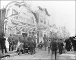 Front St. decorated with American flags for celebration, Nome, Alaska, ca. 1900.