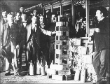 One and one half tons of gold bricks and dust inside the  Alaska Commercial Co.'s store, Dawson,...