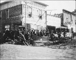 Outside of steamboat ticket office and Jo's Juneau Restaurant, Dawson, Yukon Territory, ca. 1899.